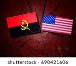 Small photo of Angolan flag with USA flag on a tree stump isolated
