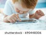 cute little boy playing with a... | Shutterstock . vector #690448306