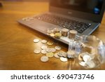 coins on computer and on the... | Shutterstock . vector #690473746