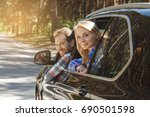 travel by car family trip... | Shutterstock . vector #690501598