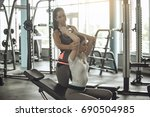 young women exercise together... | Shutterstock . vector #690504985