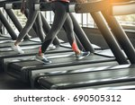 young women exercise together... | Shutterstock . vector #690505312