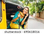 indian woman talking on phone... | Shutterstock . vector #690618016