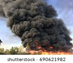 warehouse engulfed in raging... | Shutterstock . vector #690621982