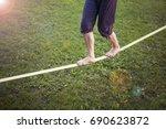 girl walking on slackline in...   Shutterstock . vector #690623872