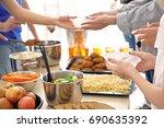 volunteers giving food to poor...   Shutterstock . vector #690635392