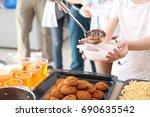 volunteer sharing food with... | Shutterstock . vector #690635542