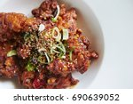 korean spicy fried chicken  | Shutterstock . vector #690639052