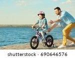 young man teaching his daughter ... | Shutterstock . vector #690646576