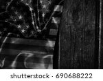 usa flag on a wood surface | Shutterstock . vector #690688222