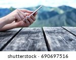 woman's hands using mobile... | Shutterstock . vector #690697516