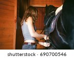 Woman Wears A Saddle Horseman...