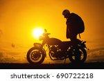 silhouette of biker man  with... | Shutterstock . vector #690722218