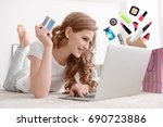 young woman using laptop for... | Shutterstock . vector #690723886