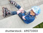 child with rollerskates and... | Shutterstock . vector #69073303