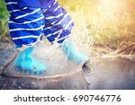 child walking in wellies in... | Shutterstock . vector #690746776