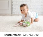 adorable little girl playing on ... | Shutterstock . vector #690761242