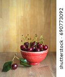 Small photo of Fresh cherries on wooden background. Season and healthy food concept. Copy space.