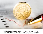 one pound coin on fluctuating... | Shutterstock . vector #690775066