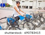 woman renting bicycle | Shutterstock . vector #690783415