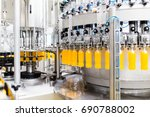 bottling factory   orange juice ... | Shutterstock . vector #690788002