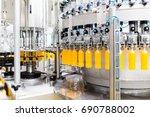 bottling factory   orange juice ... | Shutterstock . vector #690788002
