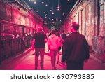 people walking on street at... | Shutterstock . vector #690793885