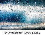 rain drops on windowpane with...   Shutterstock . vector #690812362