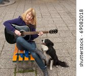 Young Female Guitar Performer...