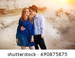 an attractive man is hugging... | Shutterstock . vector #690875875