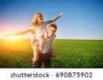 smiling man is holding on his... | Shutterstock . vector #690875902