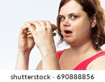 woman with a hamburger on a... | Shutterstock . vector #690888856