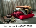 a stack of warm blankets on the ... | Shutterstock . vector #690898702