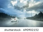 drive car in rain on asphalt... | Shutterstock . vector #690902152