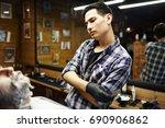 salon barber with razor looking ... | Shutterstock . vector #690906862