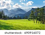 green mountain meadow with... | Shutterstock . vector #690916072