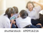 blurred of group girls students ... | Shutterstock . vector #690916216