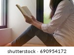women reading book and relaxing ... | Shutterstock . vector #690954172