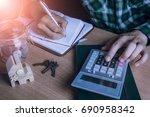 asian man accountant or banker... | Shutterstock . vector #690958342