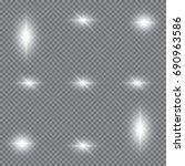 set of glowing light effects... | Shutterstock .eps vector #690963586