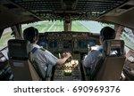 2 asian commercial pilots...   Shutterstock . vector #690969376