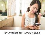 woman using smart phone | Shutterstock . vector #690971665
