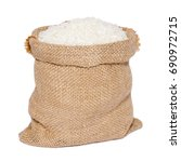 white rice in burlap sack bag... | Shutterstock . vector #690972715