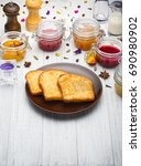 breakfast with toasts  fruits ... | Shutterstock . vector #690980902