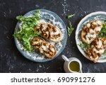 mushrooms  tartine. baked... | Shutterstock . vector #690991276