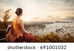 woman traveler with backpack ... | Shutterstock . vector #691001032