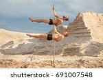 two men of acrobats dance on a... | Shutterstock . vector #691007548