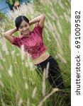 beautiful woman walking on... | Shutterstock . vector #691009582