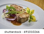 beautiful and tasty food on a... | Shutterstock . vector #691010266
