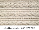 pigtails on beige knitwear... | Shutterstock . vector #691021702